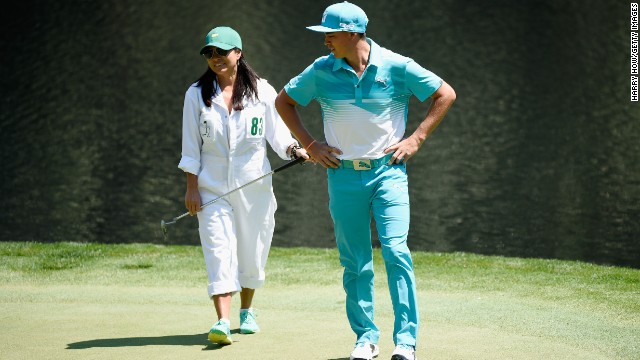 Rickie Fowler of the United States waits with his mom Lynn on the ninth green during the Par 3 Contest.