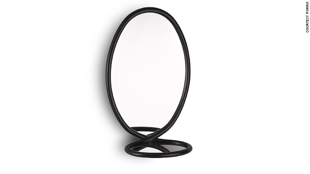 Loop mirror, also by Porro, interprets wood carving for the contemporary home. Its handcrafted timbered frame is knotted to create a loop, a symbol if infinity.