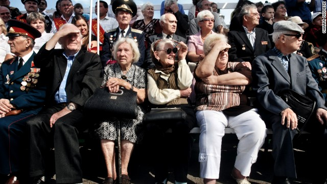 People watch the Transnistrian army and police during a parade in Tiraspol in 2009.