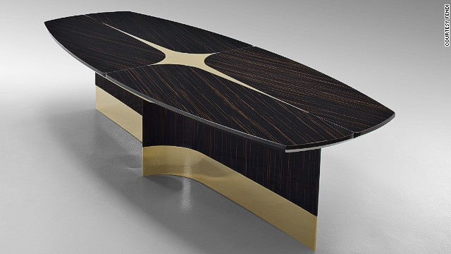 "On display was also Fendi's ""Star Table"", created in collaboration with the architect and designer Thierry Lemaire. The table is made of glossy macassar ebony, with polished brass details."