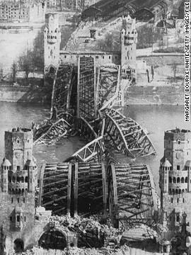 While crossing the Atlantic to North Africa, Bourke-White's transport ship was torpedoed and sunk, but she survived and continued to cover World War Two. In this photo from 1945, she shows the Hohenzollern Bridge over the Rhine in Cologne in ruins.