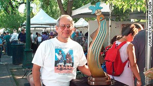 Artist Upton Greyshoes Ethelbah at his booth during the Santa Fe Indian Market.