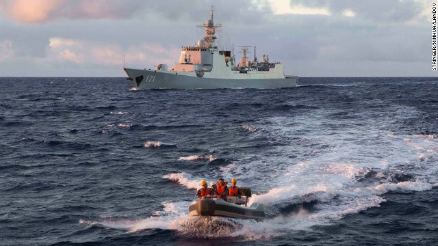 Chinese navy personnel head out on a boat to the Royal Australian Navy ship HMAS Success on Wednesday, April 9.