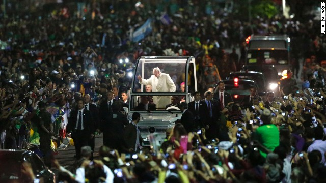 Crowds swarm the Pope as he makes his way through World Youth Day in Rio de Janeiro on July 27. According to the Vatican, 1 million people turned out to see the Pope.