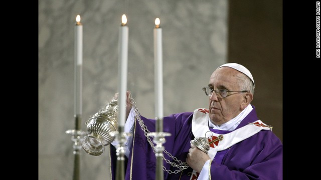The Pope blesses the altar at Rome's Santa Sabina church as he celebrates Mass on March 5, Ash Wednesday.