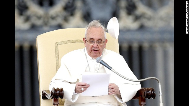 Wind blows the papal skullcap off Pope Francis' head February 19 in St. Peter's Square.