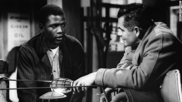 "Poitier, who was born in Miami and raised in the Bahamas, first earned note for his performance in the 1955 film ""Blackboard Jungle."" He played Gregory Miller, an inner-city tough who harasses a teacher -- played by Glenn Ford, right -- but is far from the worst of the students. The film is also notable for popularizing the song ""Rock Around the Clock."""
