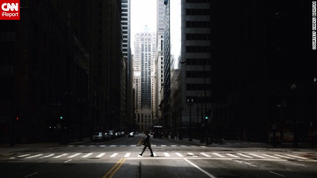A <a href='http://ireport.cnn.com/docs/DOC-1119013'>lone walker</a> crosses an urban canyon on LaSalle Street.