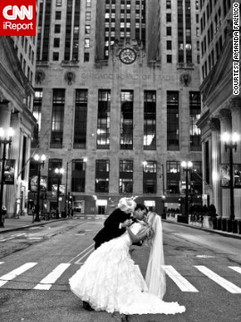 Amanda Fallico says she married the love of her life in the city she holds in the same regard. The <a href='http://ireport.cnn.com/docs/DOC-1100282'>happy couple</a> posed on LaSalle Street in front of the Chicago Board of Trade.