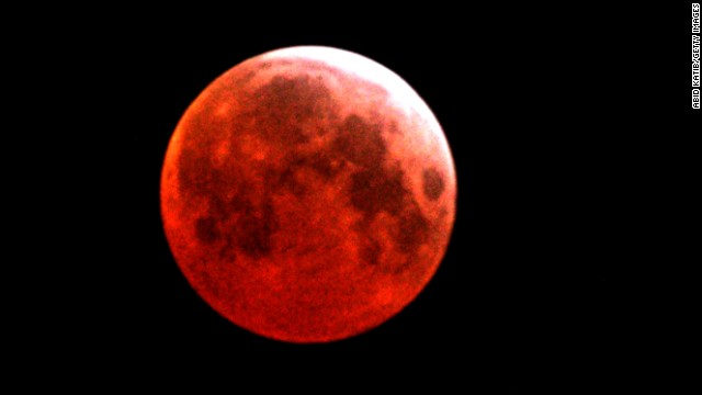 On Tuesday, April 15, there will be a total lunar eclipse that will turn the moon a coppery red, NASA says. It's called a blood moon, and it's one of four total eclipses that will take place in North America within the next year and a half. Pictured here is a blood moon seen over Gaza City in March 2007.