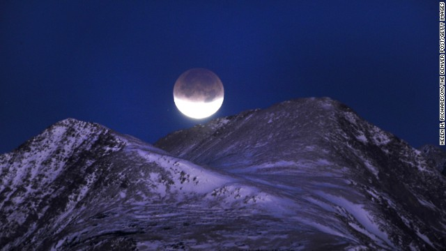 The lunar eclipse in December 2011 is almost complete before it dips behind the Indian Peaks Wilderness area near Nederland, Colorado.