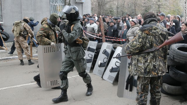 Armed pro-Russian activists carrying riot shields occupy a police station on Saturday, April 12. The unidentified armed men arrived at the building in the town of Slaviansk in the morning and took control of it without any casualties. Ukraine has seen a sharp rise in tensions since a new pro-European government took charge of the country in February. Moscow branded the new government illegitimate and annexed Ukraine's Crimea region last month, citing threats to Crimea's Russian-speaking majority.