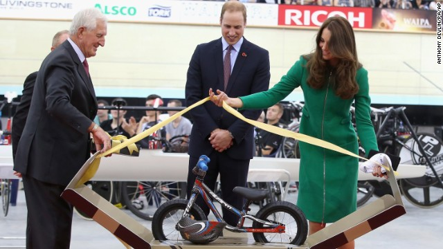 The Duke and Duchess are presented with an Avanti mini bike for Prince George during a visit to the Avanti Drome in Hamilton, New Zealand, on Saturday, April 12.