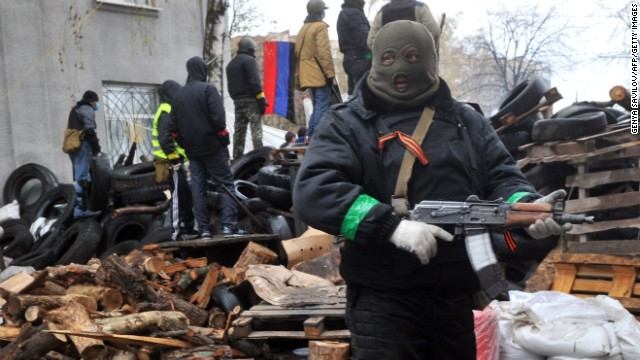 Pro-Russian protesters guard a barricade in Slavyansk on April 13 outside a regional police building seized by armed separatists the day before.