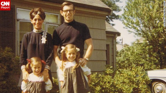 "Michelle Jones stands with her sister and parents outside her grandparents' home in Newton, Massachusetts, in this 1968 photograph. ""I loved the outfits my mom wore. Always the latest fashion. Big eyelashes and big makeup,"" she said."