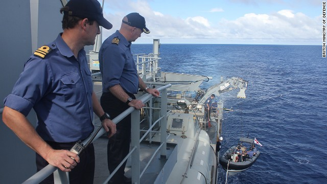 Crew members aboard the Echo watch a smaller boat that's part of the British search effort on April 13.