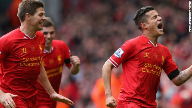 Philippe Coutinho celebrates his winning goal at Anfield with skipper Steven Gerrard.