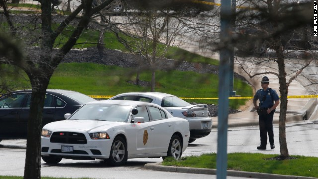 A Kansas State Trooper stands near the location of a shooting at the Jewish Community Center.