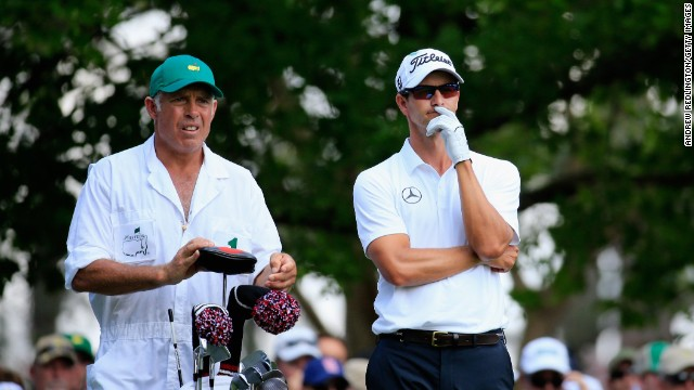 Defending champion Adam Scott is in pensive mood as he weighs a shot with caddie Steve Williams on his way to a closing 72.