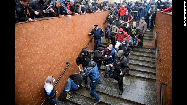 Pro-Russian supporters beat a pro-Ukrainian activist during a rally in Kharkiv, Ukraine, on Sunday, April 13.