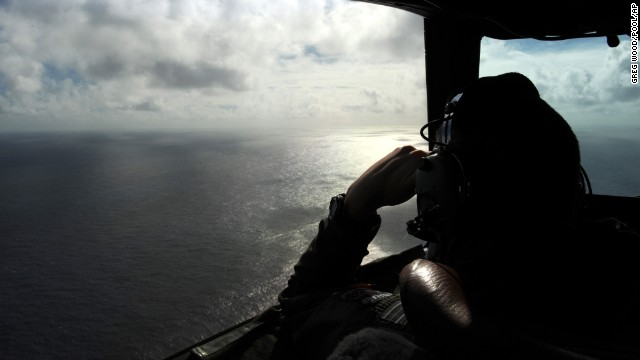 A member of the Royal New Zealand Air Force looks out of a window while searching for debris off the coast of western Australia on Sunday, April 13.