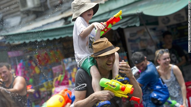 Foreign tourists take part in water battles during Thailand's Songkran Festival at Khao San Road in Bangkok (pictured). Chiang Mai has a reputation for the wildest Songkran festivities.