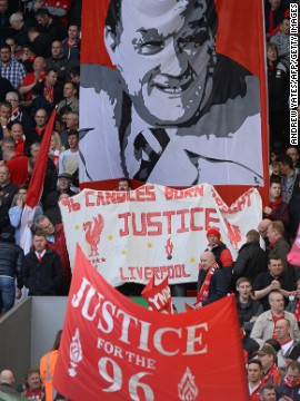 Fans in the Kop stand at Anfield wave banners in memory of the 96 victims of the 1989 disaster, which happened when supporters were crushed during Liverpool's FA Cup semifinal against Nottingham Forest.