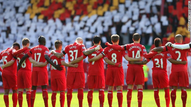 Liverpool players acknowledge a minute's silence for the Hillsborough victims on the 25th anniversary of the stadium tragedy before Sunday's 3-2 win over English Premier League title rivals Manchester City.
