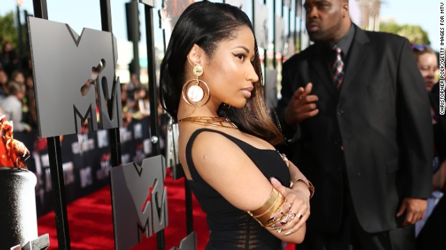 Nicki Minaj leaves the colorful accroutements at home for the 2014 MTV Movie Awards on April 13.