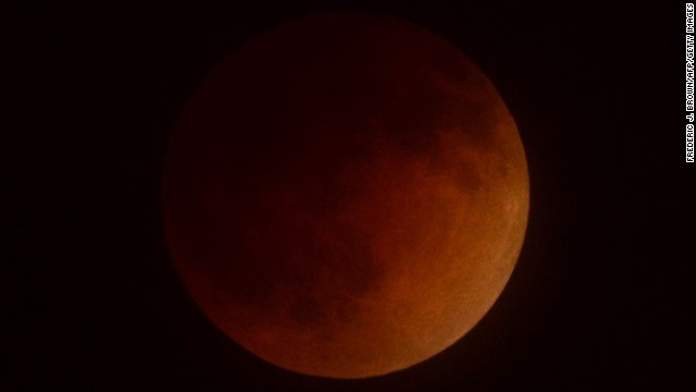 A lunar eclipse takes place over Southern California early Tuesday as seen from the San Gabriel Valley. North America will see a blood moon four times -- known as a tetrad -- between now and September 2015.