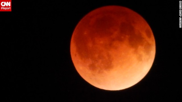 "Jason Asselin of East Kingsford, Michigan, says he nearly missed the total lunar eclipse. ""I had fallen asleep on the couch and woke up just as the full eclipse had started,"" he said."