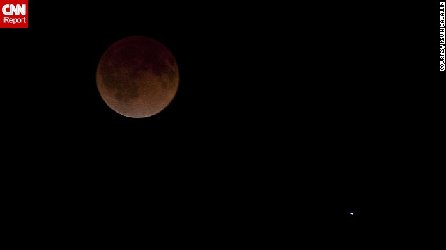 "<a href='http://ireport.cnn.com/docs/DOC-1121015'>Kevin Cavallin</a> snapped this photo in Ames, Iowa, at 2:45 a.m. local time. He captured it without a telescope, which was a challenge. ""As expected, had a difficult time getting the exposure without bad motion blur,"" said Cavallin, a laboratory technologist who enjoys photographing wildlife."