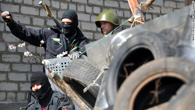 Pro-Russian activists guard a barricade April 15 outside the regional police building that they seized in Slavyansk.