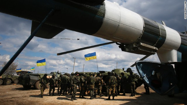 Ukrainian troops receive munitions at a field on the outskirts of Izium on April 15.