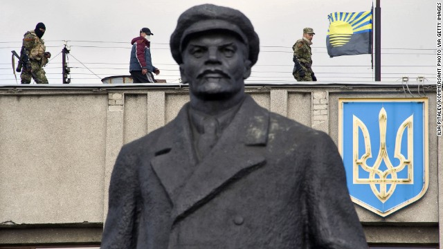 Armed pro-Russian activists stand guard on top of a Ukrainian regional administration building in Slavyansk on Monday, April 14.