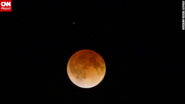 """It was a very cold 25-degree night but very peaceful outside. No wind, only coyotes howling in the distance,"" said Cheryl Lippold, who got out of bed at 4 a.m. to see the eclipse over Hiawatha, Kansas. ""I am glad I set my alarm so I could get up and watch it."""
