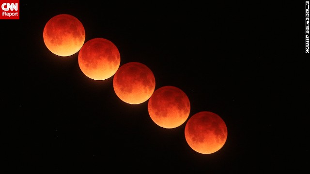 The April 15 blood moon passes over Port Orange, Florida, in this time-lapse image from Kenneth Ngyuwai.