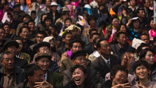 North Korean spectators watch and cheer from the stands of Kim Il Sung Stadium as runners arrive at the finish of the Mangyongdae Prize International Marathon.