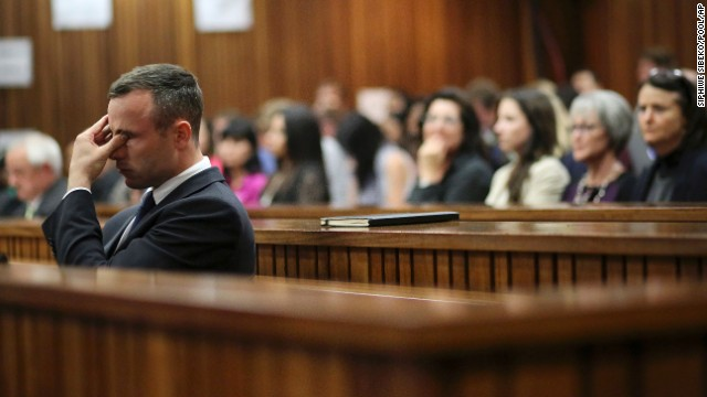Oscar Pistorius rubs his eye Tuesday, April 15, after testifying during his murder trial in Pretoria, South Africa. Pistorius, the first double amputee runner to compete in the Olympics, is accused of intentionally killing his girlfriend, Reeva Steenkamp, in February 2013. Pistorius has pleaded not guilty to murder and three weapons charges.