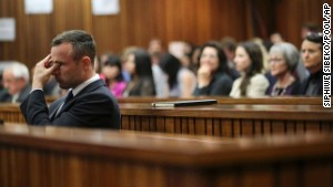 Oscar Pistorius rubs his eye during his trial in Pretoria, South Africa, on Tuesday, April 15, after testifying on the stand earlier.