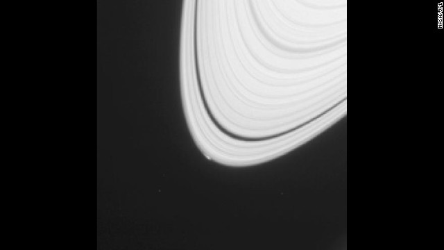 A small, bright blip can be seen on the outermost edge of Saturn's rings in this image taken in April 2013. The bump in the smooth ring structure is an icy object that could provide clues to how Saturn's moons formed.