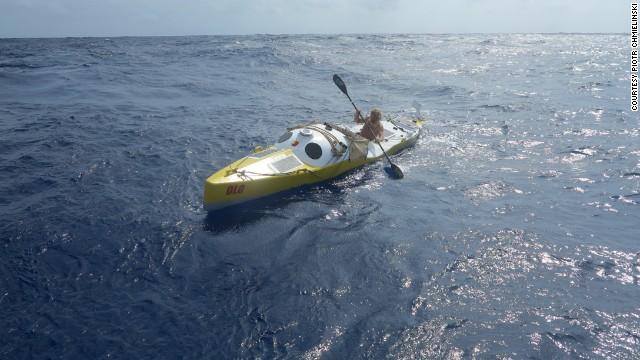 Olek Doba steers his kayak,