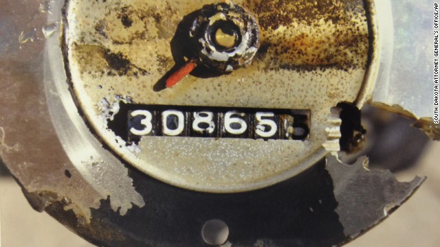 The 1960 Studebaker's ignition and headlights were turned on, and the transmission was in third gear, the attorney general said. The odometer mileage reading is seen here.