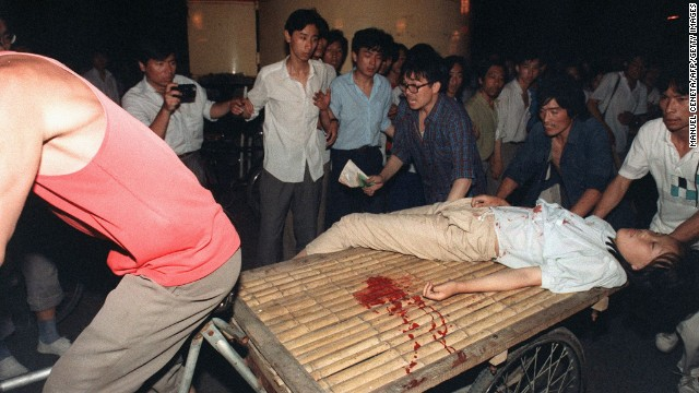 A girl wounded during the military crackdown in Beijing on June 4, 1989, is carried away on a bicycle cart.
