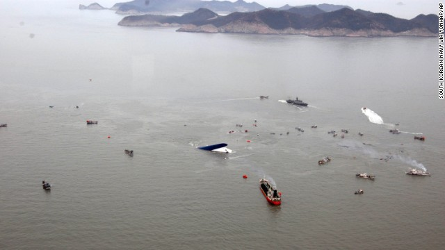 Rescue teams and fishing boats try to rescue passengers on April 16.