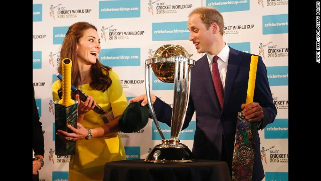 The royal couple receive cricket bats in front of the Cricket World Cup trophy at an April 16 reception at the Sydney Opera House.