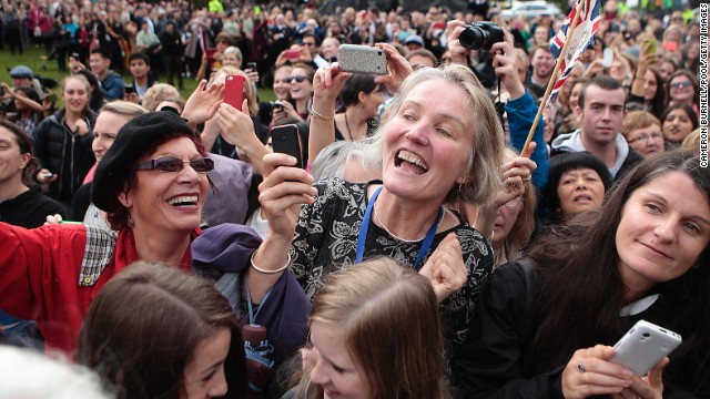 New Zealanders wait to see the royal family at Wellington's Civic Square on April 16.