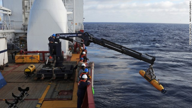 Operators aboard the Australian ship Ocean Shield move Bluefin-21, the U.S. Navy's autonomous underwater vehicle, into position to search for the jet on Monday, April 14.
