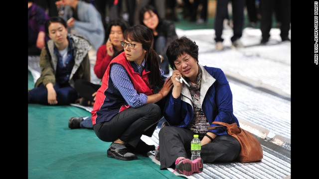 Relatives of missing ferry passengers wait for news at a gym in Jindo.