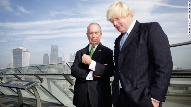 London Mayor Boris Johnson talks with Bloomberg on the balcony of London's City Hall after launching the Mayors Challenge in Europe. The Mayors Challenge is a competition, with prize money coming from Bloomberg's philanthropic foundation, that challenges cities to find innovative and creative ideas to solve problems faced by urban living.